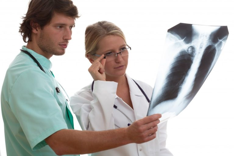 doctors looking at an xray